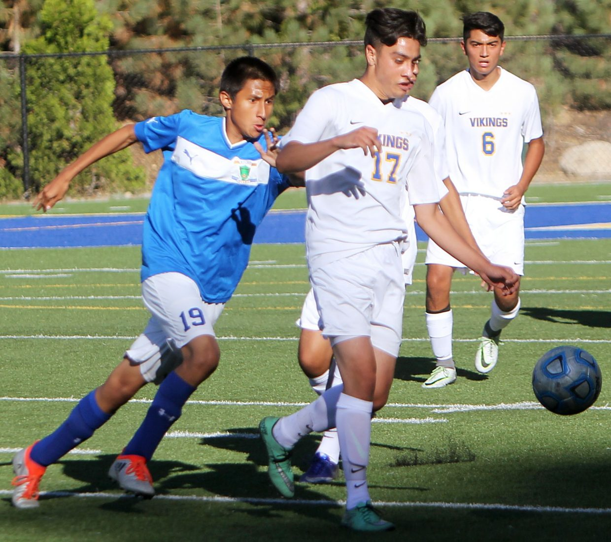 South Tahoe senior Gybran Marquez dribbles past a Lowry defender during the Vikings' league match against the Buckaroos on Wednesday, Sept. 7, at Viking Stadium.