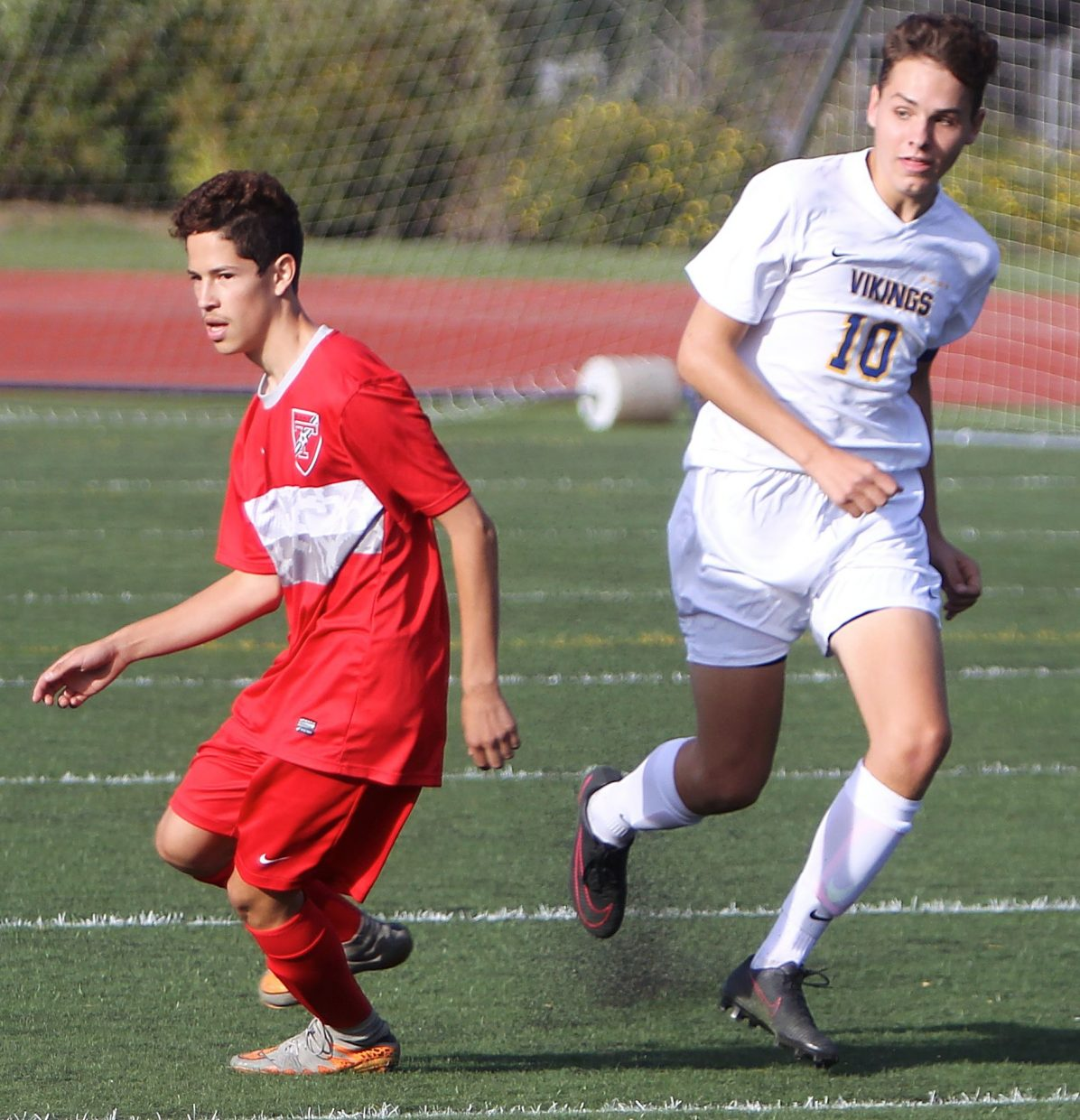 Vikings senior Lex Merrifield runs past Truckee's Joel Garcia on Tuesday.