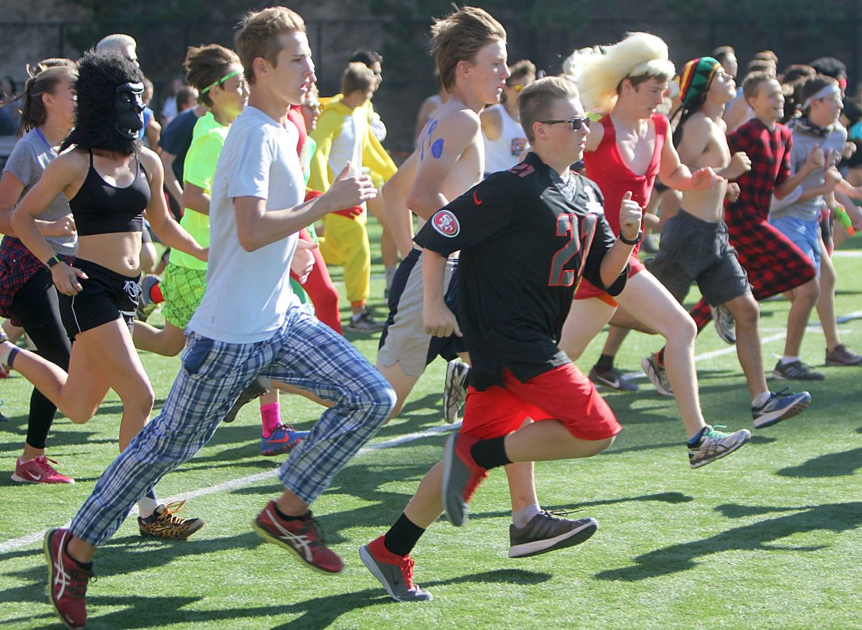 Runners in costume take off from Viking Stadium at the start of the relay race during the South Tahoe Retro Relays on Tuesday, Sept. 20.