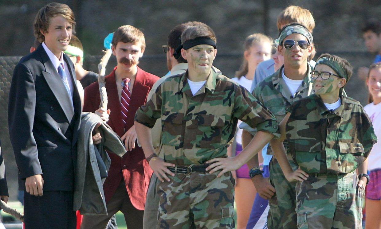 Camouflage-clad runners stand at the starting line amongst civilian costumes Tuesday.