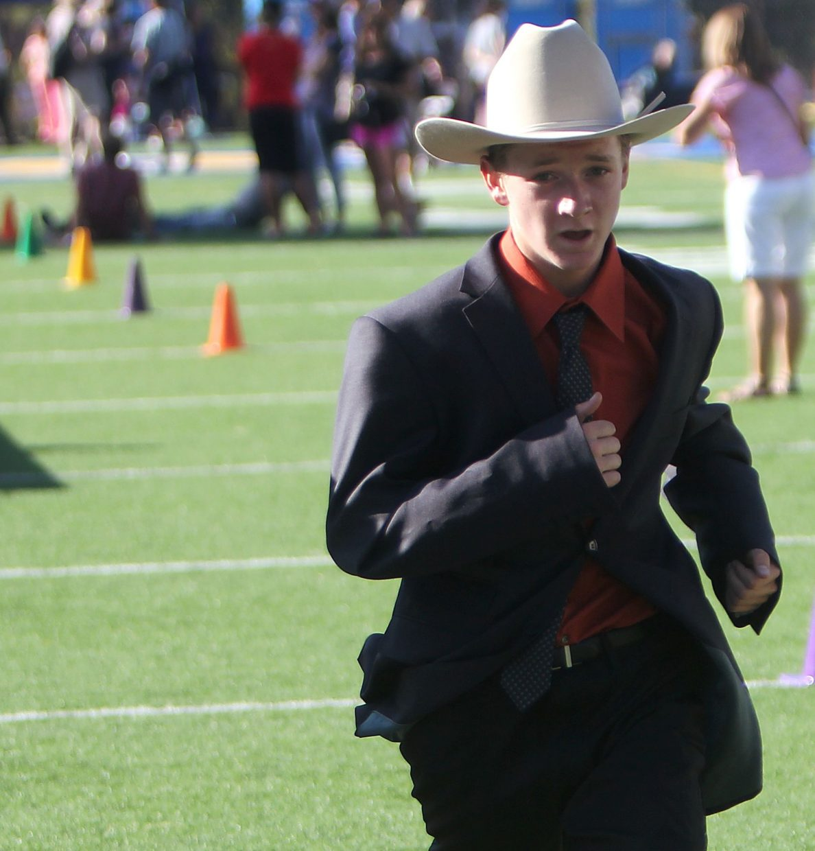 A Western businessman makes his way to the finish line Tuesday.
