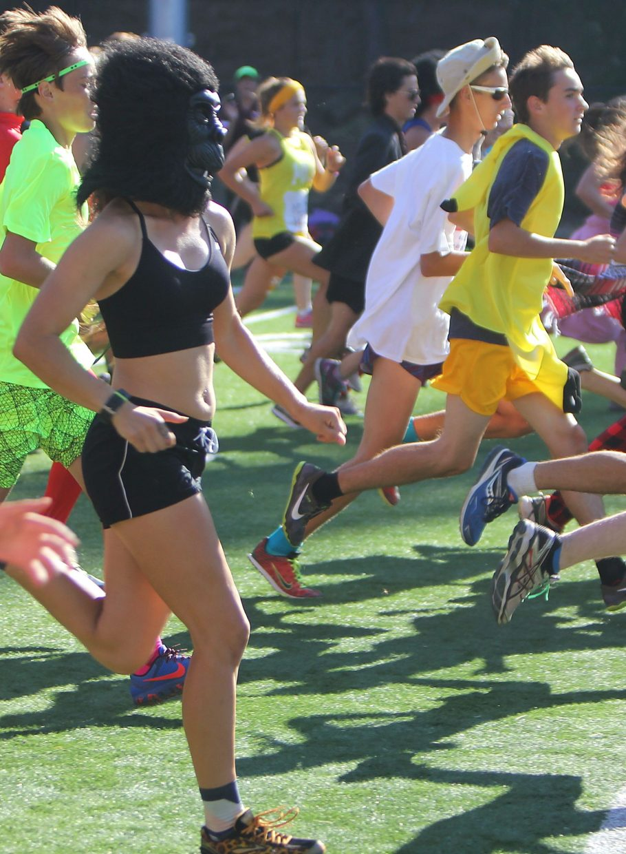 A gorilla runs in the midst of a crowd during the relay Tuesday.