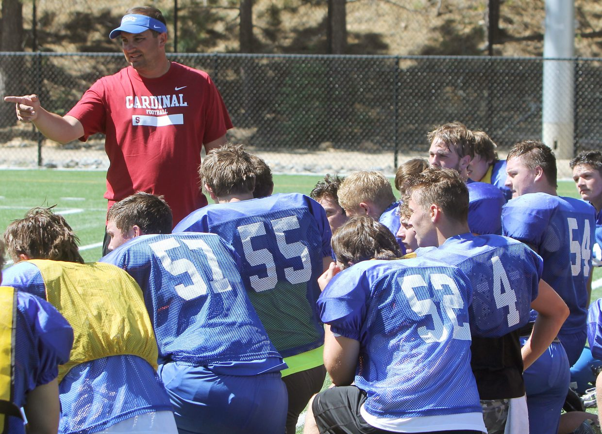 South Tahoe coach Louis Franklin addresses the team following practice Thursday, Aug. 11.