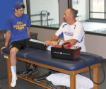 South Tahoe junior Mason Cain receives treatment from STHS Sports Medicine program director Isaiah Tannaci using one of the program's four Game Ready therapy machines during a rehab session last Thursday. Cain is in his second year in the program, and currently using it to rehab an injured knee in advance of the 2015 football season.