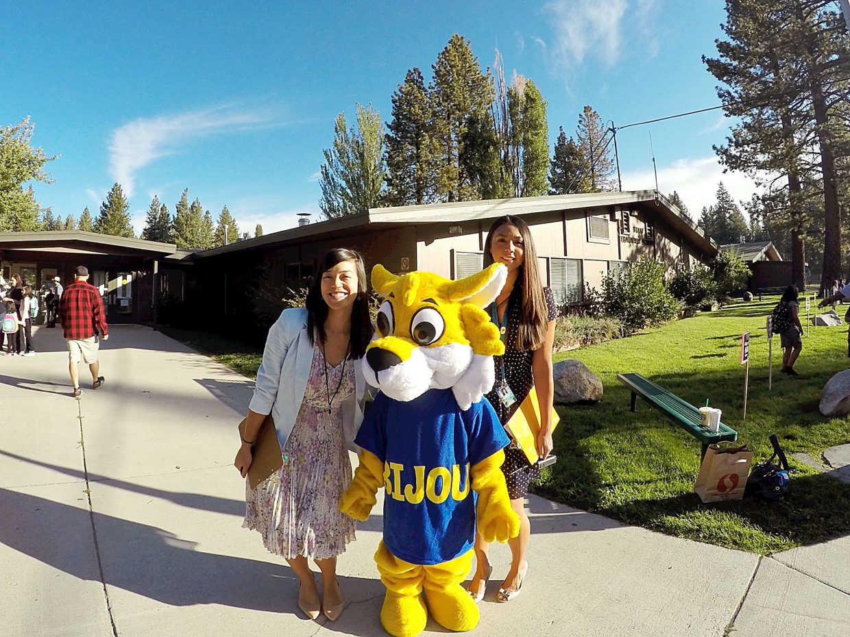Bijou Community School vice principal Alana Cayabyab and principal Cindy Martinez welcome students to the first day with the Bijou bobcat.