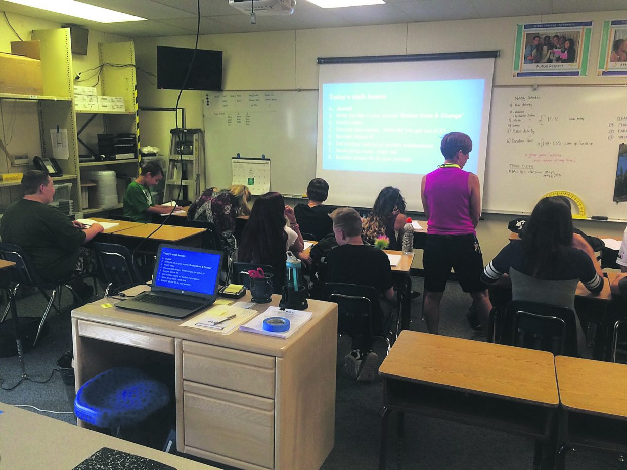 Middle school students sit in a math class on the first day of school, Monday, Aug. 29.