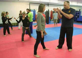 Detective Doug Sentell, right, helps instruct a free self-defense class at Escobar Training Grounds Friday evening in conjunction with Live Violence Free. Adam Jensen / Tahoe Daily Tribune