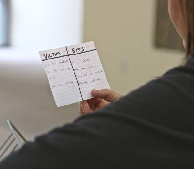 A victim reviews her notecard at the Carson City Courthouse Sunday. Instructions for actors and EMS personnel were written on cards for training purposes.