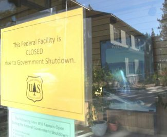 The federal government shutdown caused the Lake Tahoe Management Basin Unity to close almost all of its services and furlough employees Tuesday. A closure sign hangs on the front door of the U.S. Forest Supervisor's office Tuesday.