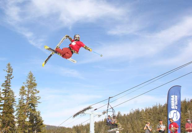A skier reaches for a grab in front of judges at Sierra-at-Tahoe Resort's annual Buckle Up Big Air competition.