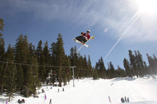 A skier reaches for a grab during Sierra-at-Tahoe Resort's annual Buckle Up Big Air competition.