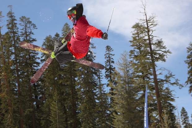 A skier airs off a jump during competition at Sierra-at-Tahoe Resort.