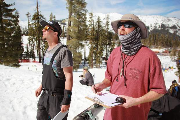 Judges look on as athletes air off of terrain park features at Sierra-at-Tahoe Resort during the mountain's annual Buckle Up Big Air competition. Athletes chose three runs to be judged during the jam session-formatted competition.