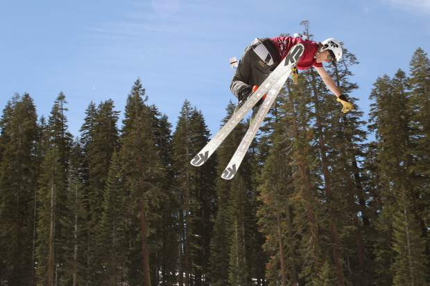 A skier eyes his landing coming out of a spin during competition at Sierra-at-Tahoe.