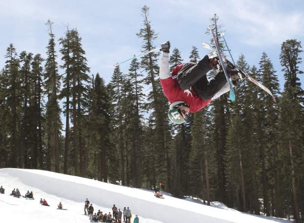 A men's open division skier goes inverted in front of the crowd at Sierra-at-Tahoe Resort during the mountain's annual Buckle Up Big Air competition.