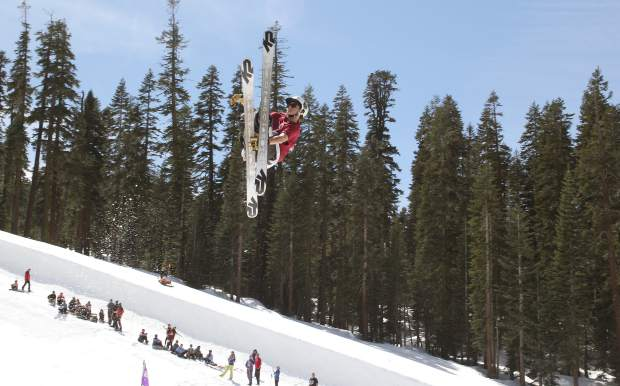 A skier reaches for a grab in front of the crowd at Sierra-at-Tahoe Resort.