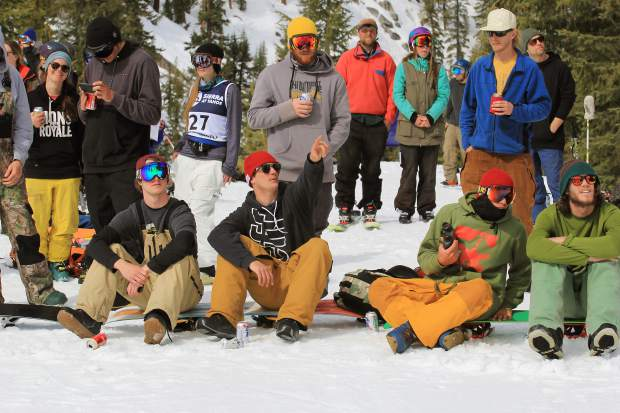 Spectators and athletes look on during the IFSA freeride competition in Huckleberry Canyon Friday.
