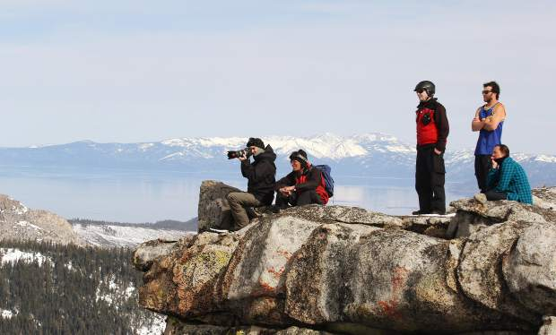 Spectators and ski patrol watch athletes compete in Friday's big mountain competition at Sierra-at-Tahoe.