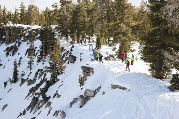 Athletes scout their lines and prepare to compete in Friday's freeride competition.