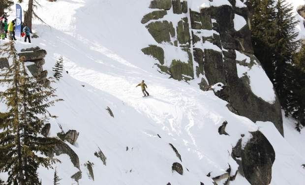 A snowboarder lines up his jump in Huckleberry Canyon.