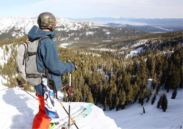 A skier scouts his line prior to competition Friday at Sierra-at-Tahoe.
