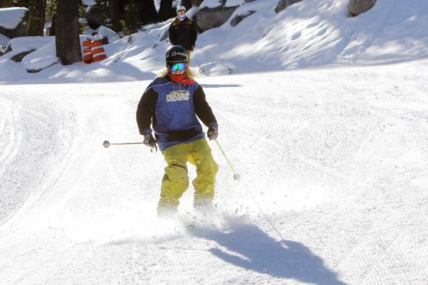 Placerville resident Andrew Eells sprays some snow during Sierra-at-Tahoe's opening day, Friday, Nov. 20.