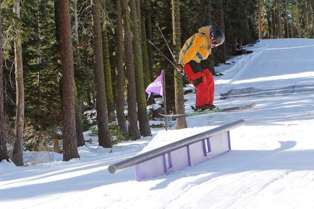 A skier launches toward a jib at Sierra-at-Tahoe on opening day Friday, Nov. 20.