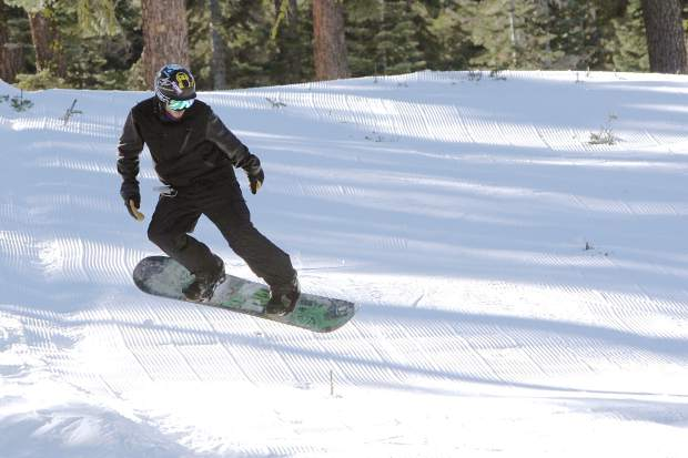 A snowboarder catches some air at Sierra-at-Tahoe Friday, Nov. 20.