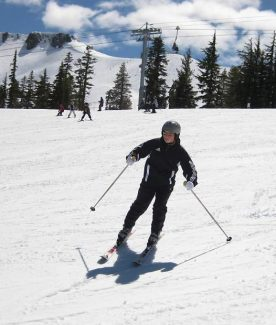 A young skier rides down Squaw Valley during a trip with SkiDUCK, a nonprofit organization that provides a free day of skiing to financially disadvantaged youth.