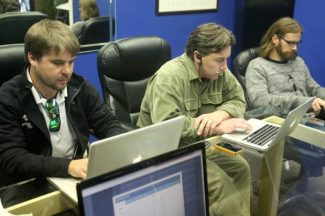 Stuart Maas, left, Kevin Sammelman, middle, and Phil Monahan work on their computers at Ski Rental Systems' Zephyr Cove headquarters Tuesday. The three South Shore residents started the company in 2010 and recently reached an international market.