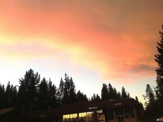 Smoke creeps in Aug. 28 from the south as the air cools in the South Lake Tahoe area. Although wind had pushed the smoke over for a portion of the day, dropping temperatures eventually returned the smoke by night.