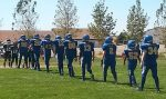 The South Tahoe Pop Warner junior varsity football team lines up to shake hands with the Silver Stage Nighthawks after their win Saturday, Sept. 10.