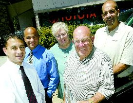Dan Thrift / Tahoe Daily Tribune From left, Toyota district managers Amir Rizkalla and Joe Carbis congratulate the Shehadi family, Wendy, Dick and Mark, on their 35 years as a Toyota dealership.