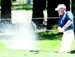 Dan Thrift / Tahoe Daily Tribune /  Dan Quinn, four-time winner of the American Century Championship, practices sand shots on Hole 6 on Monday at Edgewood Tahoe Golf Course.