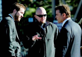 """Sacramento native and Tahoe visitor Joe Carnahan, center, wrote and directed """"Smokin' Aces"""" with the South Shore in mind. Carnahan and crew were at Tahoe for two weeks in October 2005. Ryan Reynolds, left, and Ray Liotta, right, are among the film's stars. (Universal Pictures)"""
