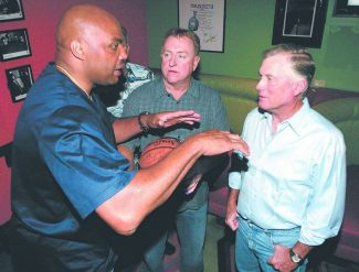 Dan Thrift / Tahoe Daily Tribune /  Charles Barkley, left, explains to former vice-president Dan Quayle, right, what he saw when taking a tour of the Angora Fire area while at Cabo Wabo on Saturday night. Middle is Rick Nicholson, form the Tahoe-Douglas Fire Protection District, who received a signed basket ball from Barkley to be auctioned at the upcoming Firemans Ball.