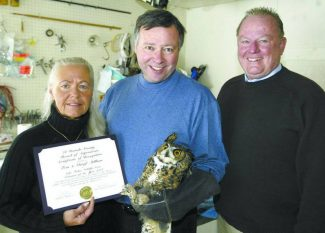 Jim Grant / Tahoe Daily Tribune /  El Dorado County Supervisor Dave Solaro, right, presents the Volunteer of the Year award to Cheryl and Tom Millham of Lake Tahoe Wildlife Care in 2005.