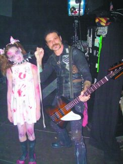 Here's what take-your-daughter-to-work day looks like in the rock 'n' roll world: Chuck Garric and his daughter, Alisha, backstage before an Alice Cooper concert in Europe.