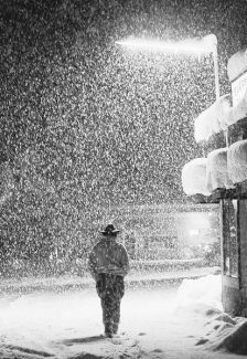 Tribune file photoCharlie Rider of South Lake Tahoe walks through the falling snow in this image from March 27, 1991.