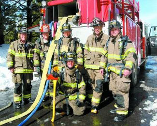 Jim Grant / Tahoe Daily TribuneLake Valley firefighters Chad Stephens, standing on left, Capt. Brad Zlendick, Jan Bojsen-Moller, Capt. Scott Swift, Tony Gasporra and Mitch Underhill, kneeling in front, invite the community to the 46th annual Firefighters Ball.