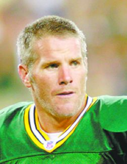 **FILE** Dallas Cowboys quarterback Tony Romo, left, and Green Bay Packers Brett Favre, right, are seen in these 2007 file photos. With playoff positioning at stake for the Packers and Cowboys, who play Thursday, Nov. 29, 2007, Favre doesn't really want to play along with one of the game's most compelling story lines. Still, Favre has to admit that there are some striking similarities between himself and Romo. (AP Photo/File)