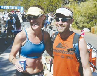 Steve Yingling / Tahoe Daily TribuneTruckee's Gretchen Brugman, left, and Sean Meissner of Sisters, Ore., claimed Lake Tahoe Marathon titles on Sunday at Pope Beach in South Lake Tahoe.