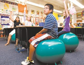 Shannon Litz / Tribune News ServiceJudy Leon, Alyssa Wing, Andres Ortiz and Madison Vickers sit on their stability balls in Dana Rosingus' class at Gardnerville Elementary School last week.