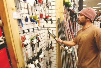 Adam Jensen / Tahoe Daily TribuneSports Ltd. employee and backcountry skier Dave Salazar displays a set of Alpine Touring bindings Thursday. Backcountry skiing and snowboarding has shown a marked increase in popularity in recent years.