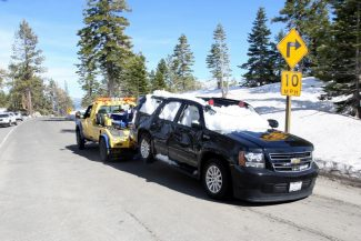 Dylan Silver/Tahoe Daily TribuneThe vehicle that was buried in the slide is towed down Highway 89.