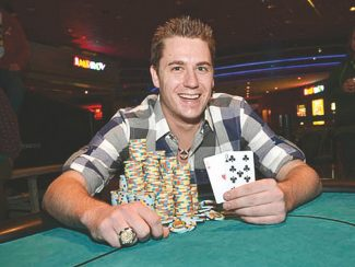World Series of Poker / Provided to the TribuneIllinois resident Bryan Schultz shows off his winning hand in the World Series of Poker Harveys Lake Tahoe Circuit Event No Limit Hold'em Main Event Tuesday. Schultz won $111,812 for winning the circuit stop's biggest tournament.