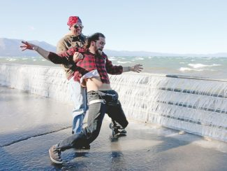 Adam Jensen / Tahoe Daily TribuneSouth Lake Tahoe resident Garrett Murphy tries to hold up friend Brian Hirdman at Regan Beach Thursday afternoon. High winds and cold weather turned the walkway at the beach into an ice skating rink for the pair and two of their friends.