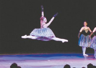 """Tara PielaetMelissa Jo Marsh gets serious airtime as the Sugarplum Fairy on Sunday during the holiday production of """"Twas the Night Before Christmas."""""""
