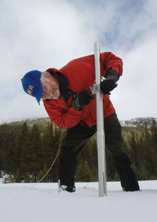 Frank Gehrke, chief of snow surveys for the Department of Water Resources, checks the snowpack depth during the snow survey near Echo Summit Calif., Wednesday, Feb. 1, 2012. Despite recent storms the survey showed the snow pack to to only 15.6 inches deep with a water content of only 3.8 inches which is only 19 percent of normal for this location at this time of the year.(AP Photo/Rich Pedroncelli)