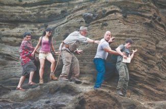 """(L-r) LUIS GUZMÁN as Gabato, VANESSA HUDGENS as Kailani, MICHAEL CAINE as Alexander, DWAYNE JOHNSON as Hank, and JOSH HUTCHERSON as Sean in New Line Cinema's family adventure """"JOURNEY 2: THE MYSTERIOUS ISLAND,"""" a Warner Bros. Pictures release."""